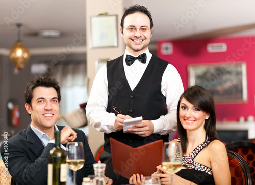 Waiter serving a couple