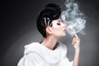 beautiful woman wearing make-up and hairstyle while smoking