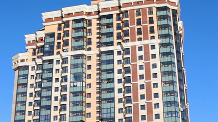 The facade of a high-rise apartment building. Camera review