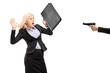 Afraid businesswoman from a gun