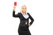 Angry businesswoman holding a red card