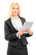 Smiling businesswoman wearing black suit, holding a tablet