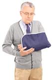 A senior man with a broken arm posing