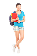 Full length portrait of a female student with backpack holding n