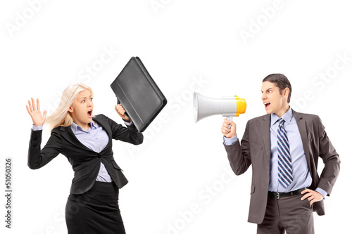 An afraid businesswoman and her manager shouting with a speakerp