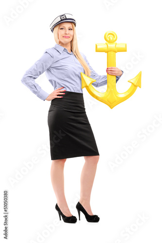 Full length portrait of a young sailor woman with an anchor