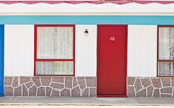 Motel with red and blue doors
