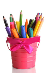 Colorful pencils and felt-tip pens in pink pail isolated