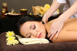 Beautiful young woman in spa salon getting massage,