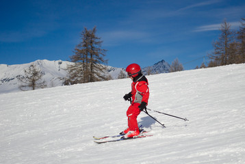 Child skiing in a sunny day