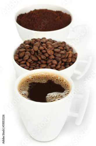 Different types of coffee in three cups isolated on white