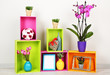 Beautiful colorful shelves with different home related objects