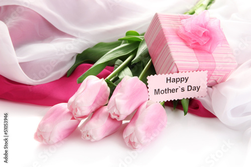 Bouquet of pink tulips and gift