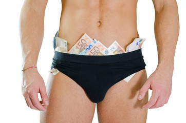 Close-up of male stripper underwear full of money banknotes