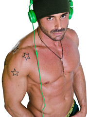 Muscular tanned shirtless man with headphones