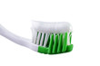 Toothbrush with toothpaste isolated over white