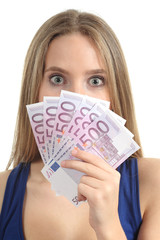 Woman surprised  holding a lot of five hundred euro banknotes