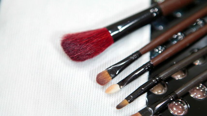Make-up brushes with color cosmetic palette. Camera rotation