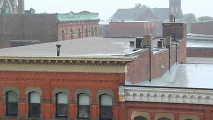 Heavy rain falling on buildings. Saint John, NB.