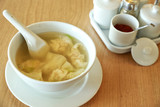 Wonton soup with spoon in a bowl. Traditional asian food poster