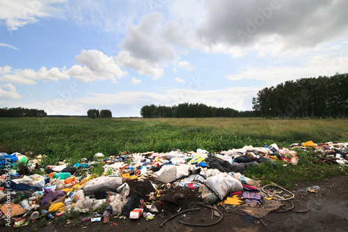 Garbage dump on the side of the fields.