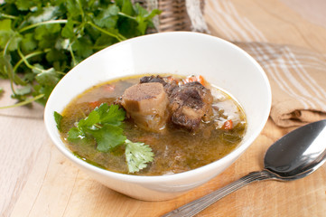 Soup with meat and bone and parsley