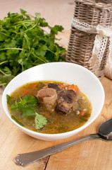 Beef tail soup with parsley and barley