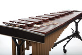 A brown wooden marimba on a white background