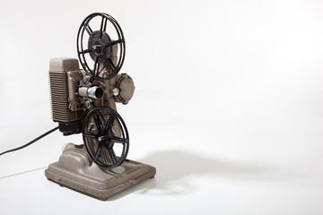 A vintage movie projector on a white background with copy space