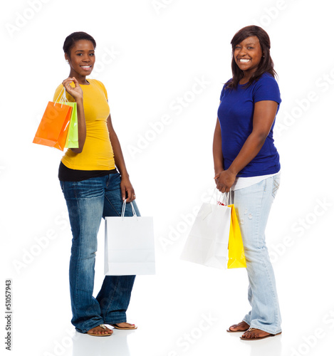 Two young African American friends with shopping bags