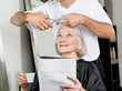 Senior Woman Having Haircut At Salon