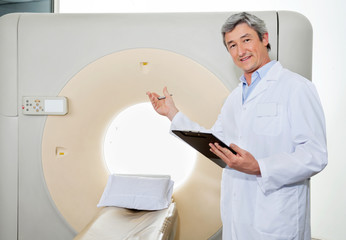 Male Doctor Presenting The CT Scan Machine