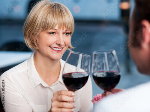 Couple toasting in a restaurant