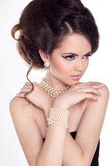 Pearls. Beautiful woman with evening make-up. Jewelry and Beauty