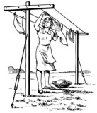 Woman hanging the linen in the yard