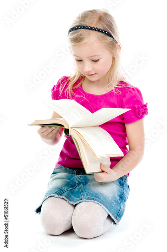 Small and beautiful girl reading a book © korvin1979