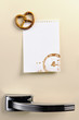 Blank note on fifties fridge door with Pretzel magnet