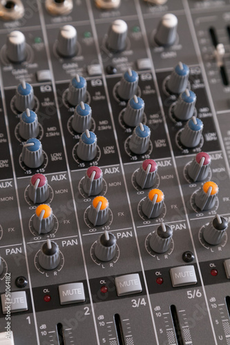 Closeup of audio mixer with filter knobs