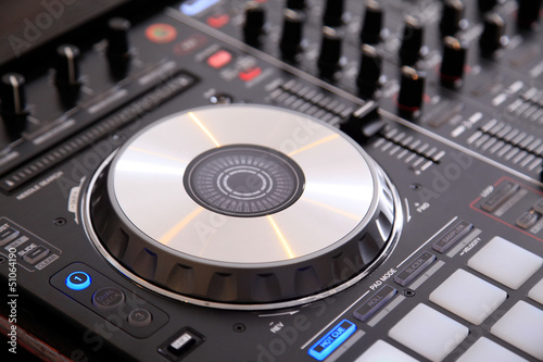Closeup of dj controller with jog wheel
