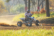 Quad rider in autumn forest