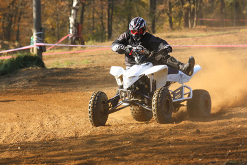 Front view of quad motorbike rider
