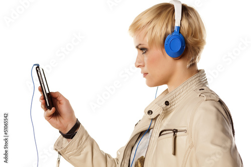 blonde girl, downloading music on her phone