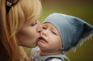 mother calms her weeping daughter