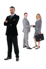 Three businesspeople on a white background