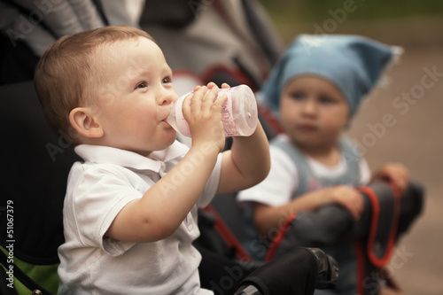 cute baby drinks juice