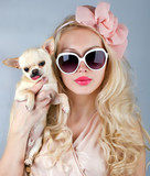 Beautiful woman with chihuahua in hands