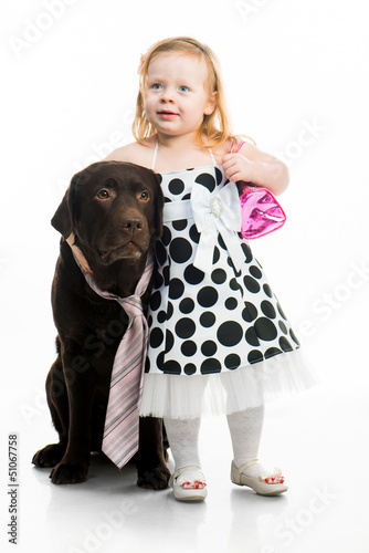 little girl with retriever