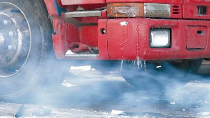 Truck repairing defrosting of the diesel engine