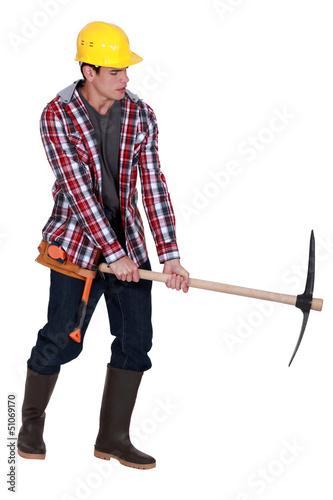 craftsman holding a pick