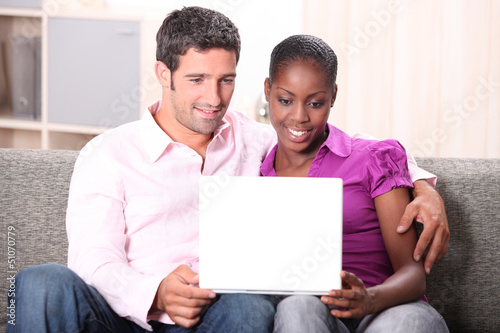 Couple watching laptop screen